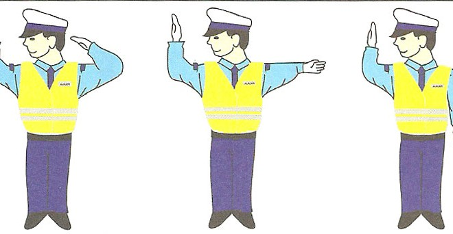 Kierujący ruchem drogowym – policjant